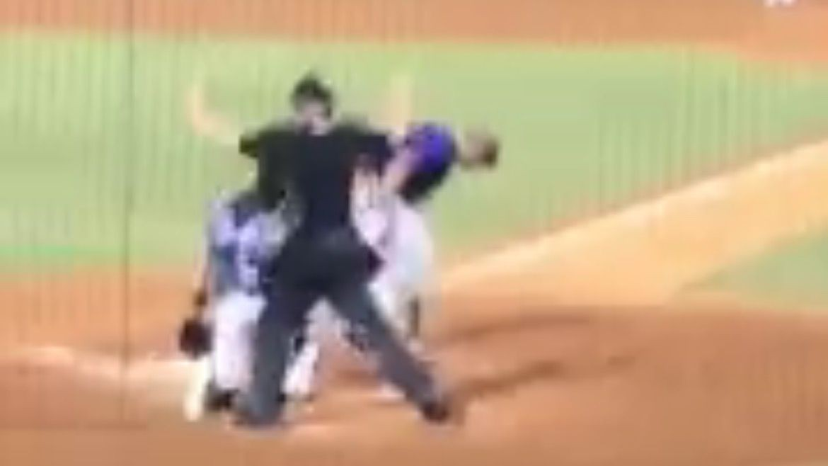 VIDEO: Tim Tebow takes pitch to the head, stays in game
